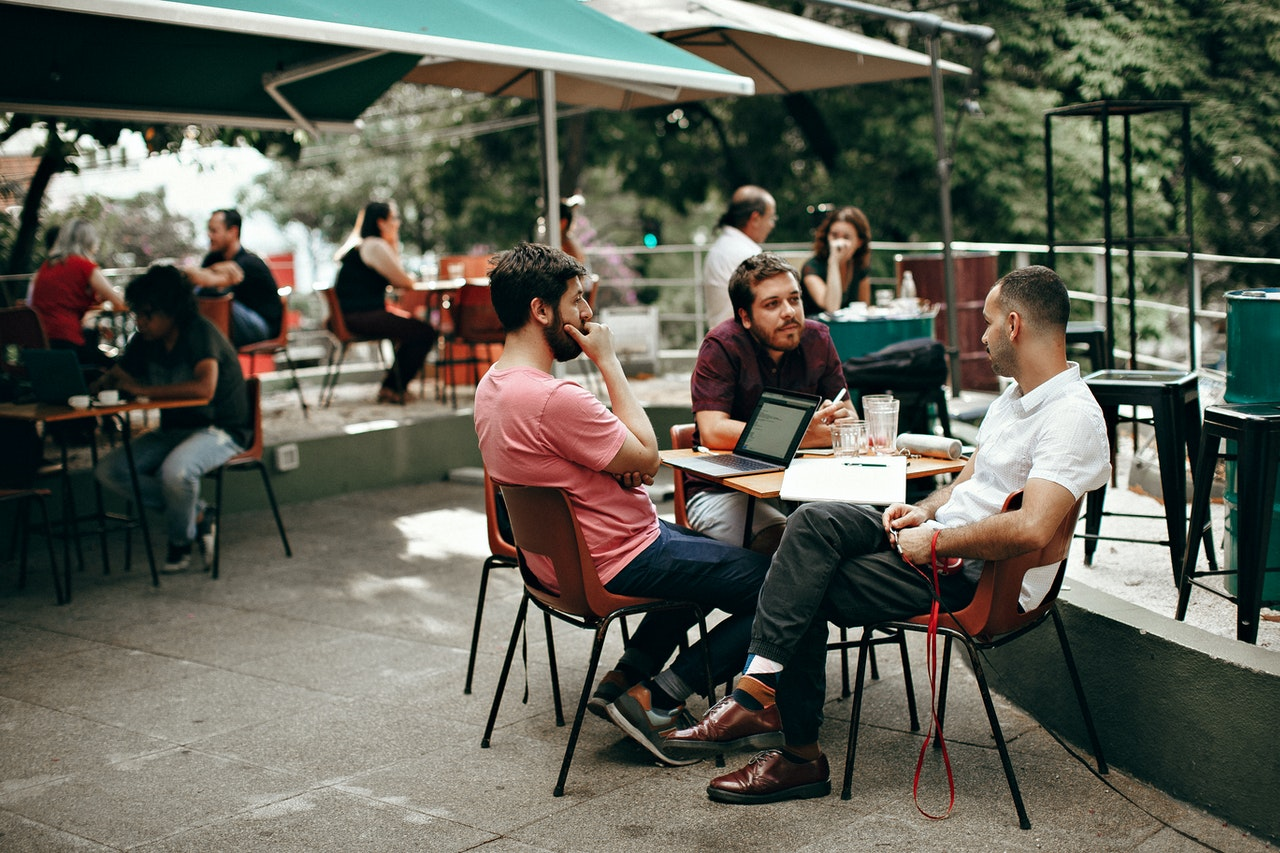 three-men-sitting-at-the-table-3215527